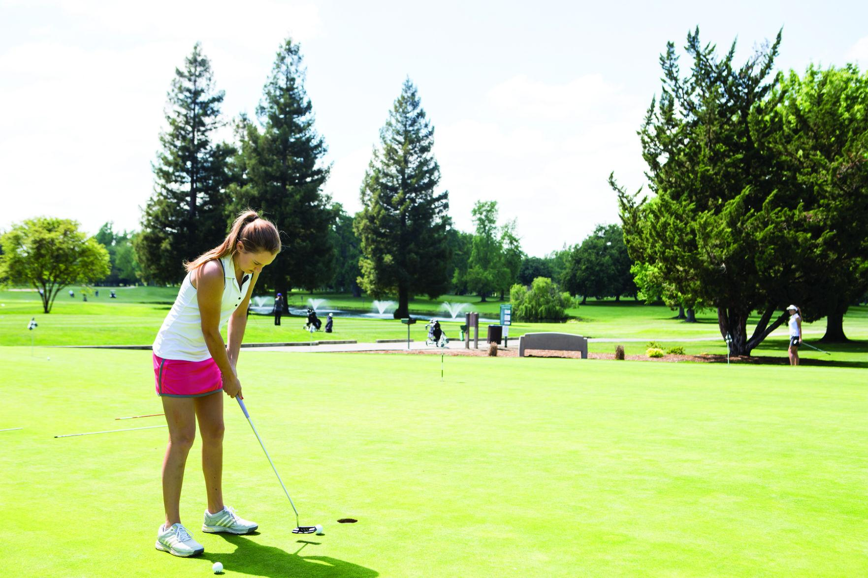 Sophomore Katie Dunaway prepares for a putt during an afternoon practice on Monday, April 11.