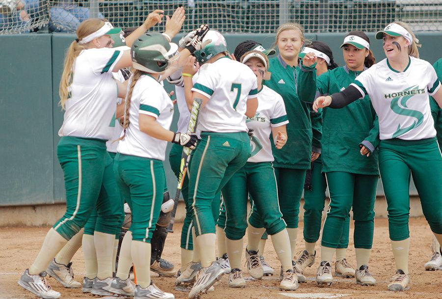 Junior Kailey Olcott celebrates with her teammates after a homerun in game 2 against Portland State at Shea Stadium, Friday, May 6.