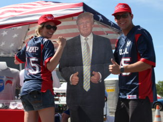 Trump supporters Cathy Landtroop and Austin Taylor pose with their life-size cardboard cutout of the presumptive Republican nominee at the rally, Wednesday, June 1.