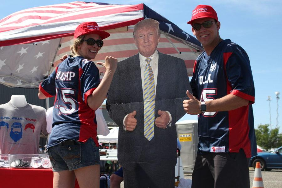Trump+supporters+Cathy+Landtroop+and+Austin+Taylor+pose+with+their+life-size+cardboard+cutout+of+the+presumptive+Republican+nominee+at+the+rally%2C+Wednesday%2C+June+1.