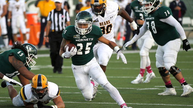 Running back Jordan Robinson sprints past Northern Colorado University defenders on Saturday, Oct. 3, 2015 at Hornet Stadium. Robinson lead the team in rushing with 149 yards on 28 carries. (Photo by Francisco Medina)