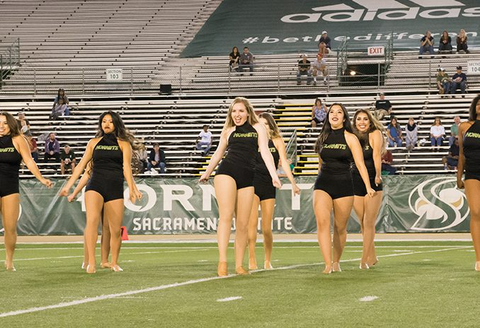 Sacramento State Hornet dance team performs during halftime at Hornet Stadium on Oct. 8. (Photo by Matthew Dyer)