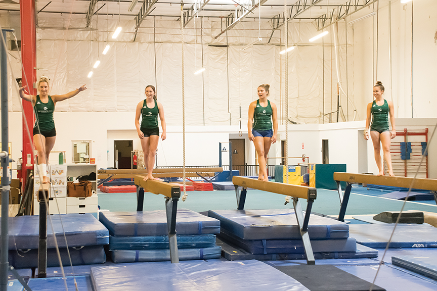 The Sacramento State women's gymnastics team practices on the balance beam at Elevate Gymnastics in Elk Grove on Saturday, Sept. 30. The Hornets had four gymnasts advance to the NCAA West Regionals last season. (Photo by Matthew Dyer)