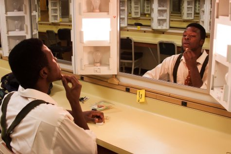 Hickman puts on makeup during rehearsal for 'The Diviners.' (Photo by Jessica Wilson)