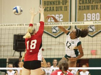Sacramento State sophomore middle blocker Brie Gathright spikes the ball past Kimberly Brinkworth of Eastern Washington at the Hornets Nest on Saturday, Oct. 22. (Photo by Matthew Dyer)