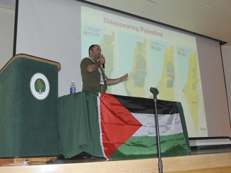 Activist Issa Amor speaks in the Hinde Auditorium at Sacramento State on Wednesday night about the what is currently occurring in the Palestinian territories. He was invited by Students for Justice in Palestine, an organization on campus. (Photo by Paola Lupercio)