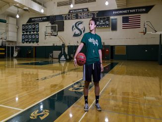 Sacramento State junior shooting guard Taylor Brown brings her love of religion to the women's basketball team. (Photo by Francisco Medina)
