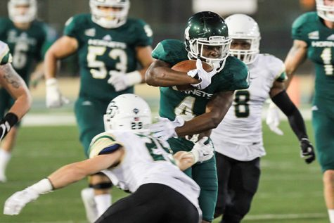 Sacramento State senior running back Demetrius Warren avoids a tackle from a Cal Poly defender on Saturday at Hornet Stadium. Warren accumulated 79 rushing yards in the 47-59 loss to Cal Poly.