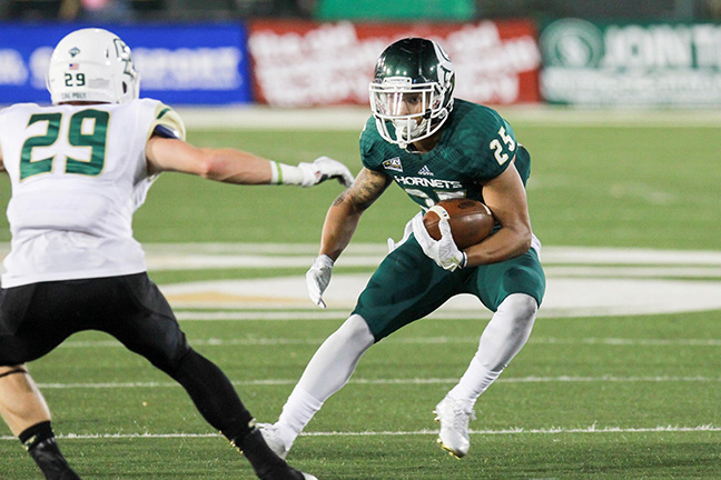 Sacramento State senior running back Jordan Robinson jukes a Cal Poly defender on Saturday at Hornet Stadium, Robinson led the Hornets in rushing with 117 yards and two touchdowns. (Photo by Francisco Medina)
