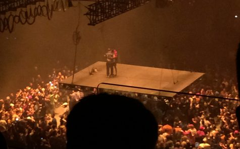Kanye West hugs Kid Cudi on the hovering platform during his concert at the Golden 1 Center, Saturday, Nov. 19. (Photo courtesy of Jasmine Singh)