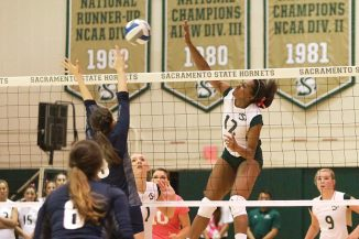 Sacramento State sophomore midblocker Brie Gathright spikes the ball against Northern Arizona at Colberg Court on Oct. 27. (Photo by Matthew Dyer)