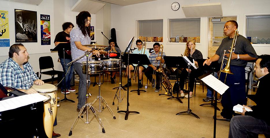 Members of the Latin Jazz Ensemble rehearsal for their Nov. 29 concert inside Capistrano Hall. (Photo by Marivel Guzman)