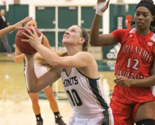 Sacramento State senior forward Margaret Huntington attempts a shot against Holy Names defenders at the Nest on Oct. 30. (Photo by Matthew Dyer)