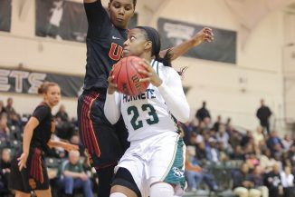 Sacramento State junior guard Dajhae Mullins drives to the basket for a layup against a USC defender at the Nest on Saturday, Dec. 3. (Photo by Matthew Dyer)