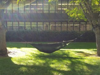 Sophomore criminal justice major Matthew Smith lies on a hammock he hung between two trees in the pathway of Alpine and Calaveras halls. (Photo by Joel Boland)
