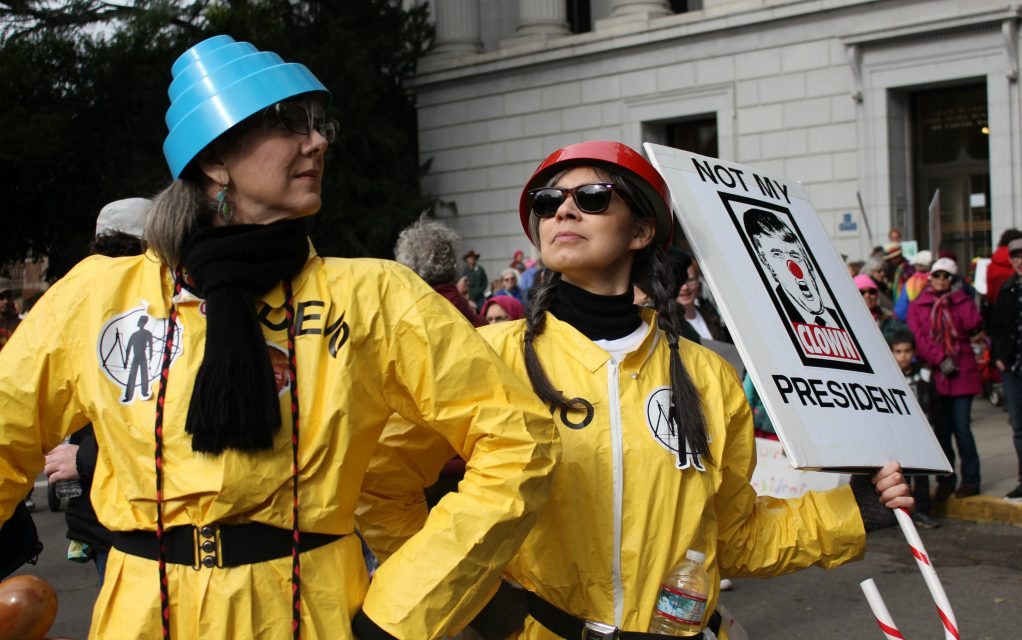 Two demonstrators dressed as members of the band Devo pose for pictures at the Women's March on Sacramento at the State Capitol on Saturday, Jan. 21, 2016. (Photo by Barbara Harvey)