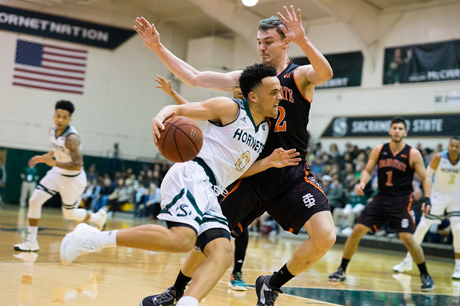 Sacramento State junior guard Marcus Graves drives in for a layup against Idaho State Feb. 11 at the Nest. (Photo by Michael Zhang)