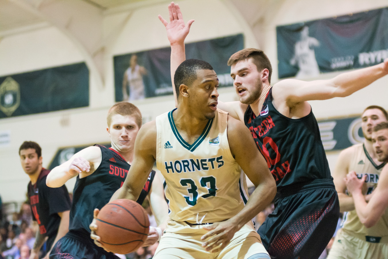 Sacramento State senior forward Nick Hornsby backs down Jacob Calloway of Southern Utah in the post Feb. 26 at the Nest. (Photo by Matthew Dyer)