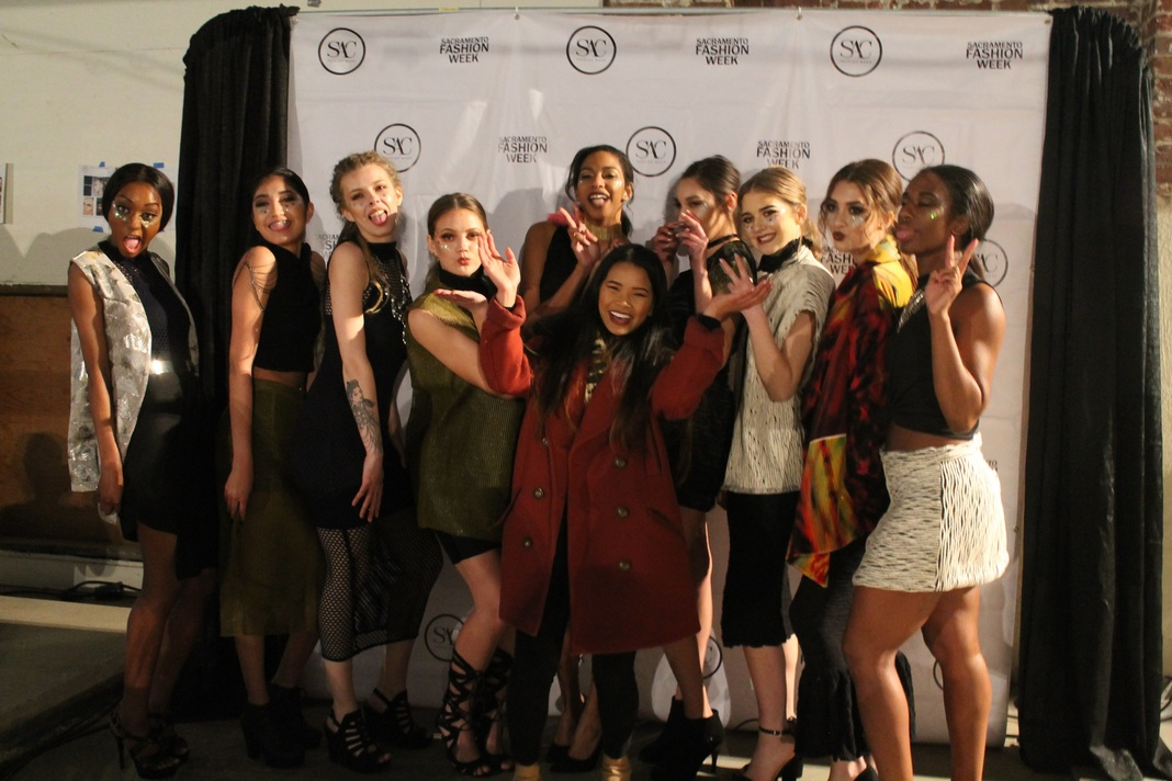 Sac State alumna Theresa Truong joins her models in their final walk of the show on Friday, Feb. 24 at Sacramento Fashion Week. (Photo by Sami Soto)