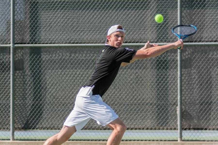 Sacramento State sophomore Dom Miller backhands the ball during a doubles match against Grand Canyon in the Golden State Invite Saturday at the Sac State tennis courts. (Photo by Matthew Dyer)