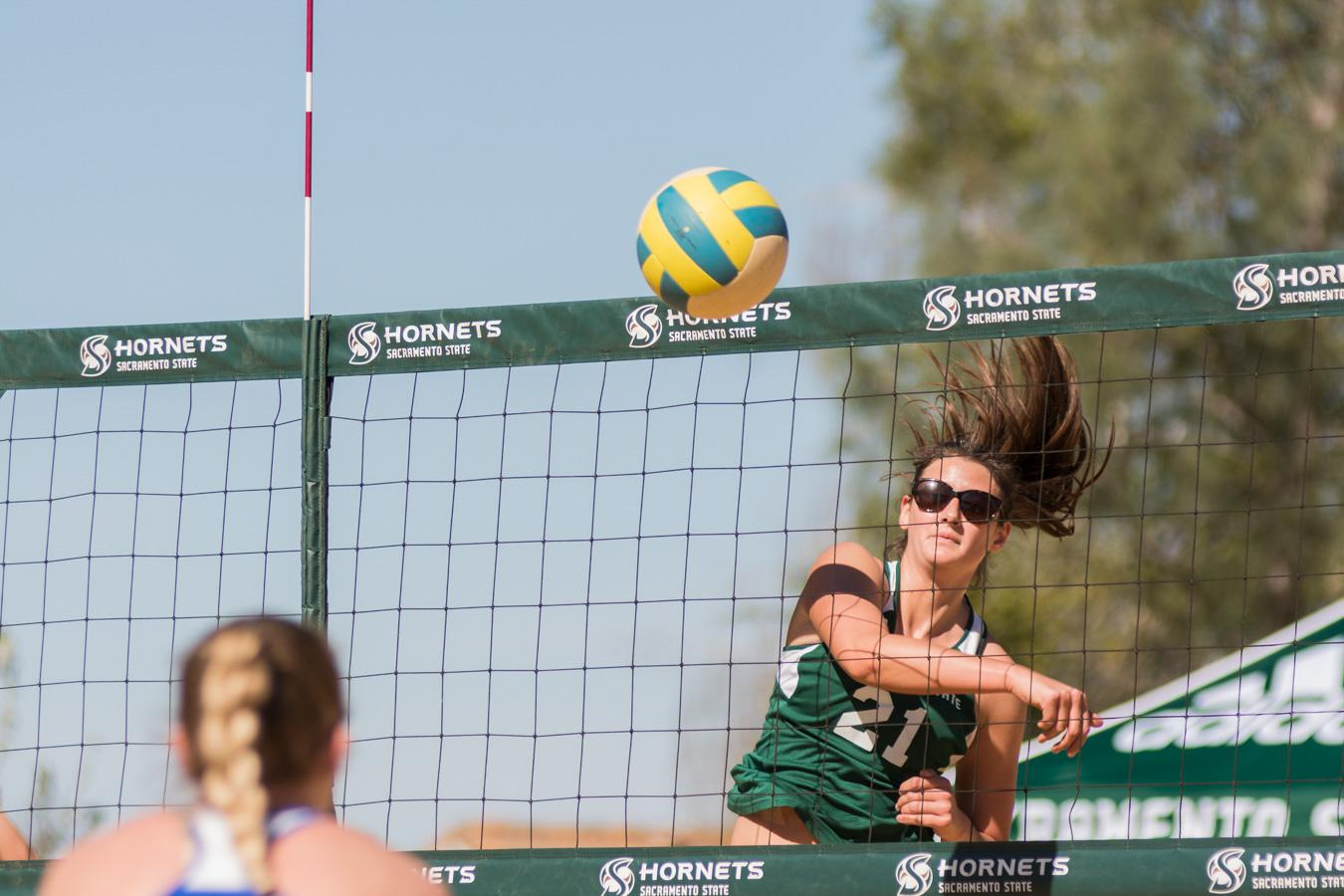 Sacramento State senior Madeline Cannon spikes the ball for a point against Boise State Sunday at the Livermore Community Park. (Photo by Matthew Dyer)