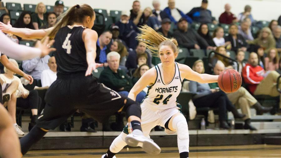 Sacramento State senior forward Gretchen Harrigan passes the ball to a teammate against Idaho at the Nest on Feb. 4. Harrigan is one of three seniors who combined to miss a total of 52 games in the 2016-17 season. (Photo by Matthew Dyer)