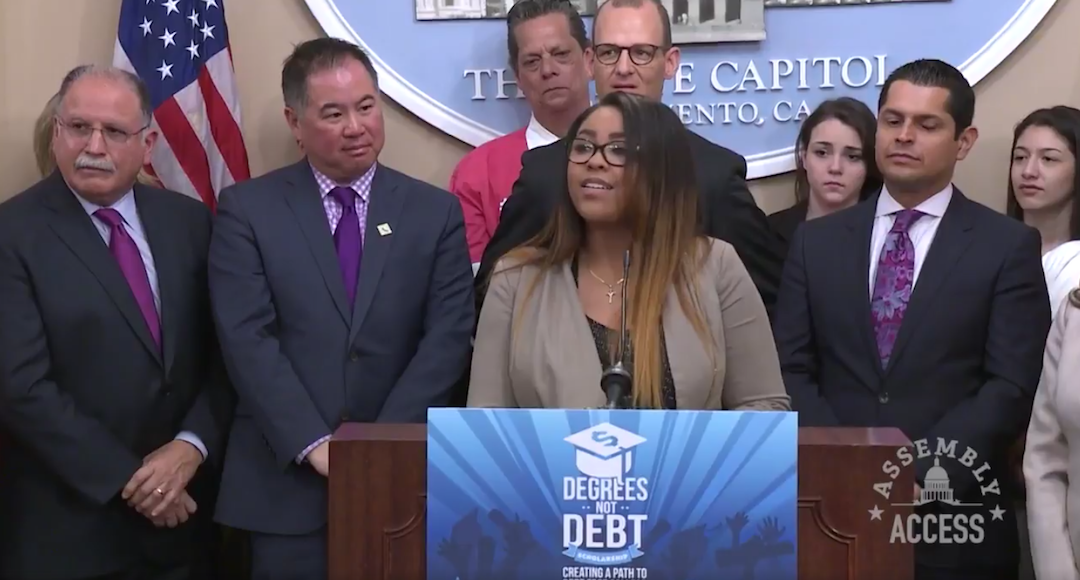 Sacramento State senior Monique Graham speaks at a press conference at the Capitol building on Monday. Graham said she works 30 hours a week, and yet anticipates graduating with $40,000 in student loan debt. (Screenshot via Anthony Rendon / Twitter)