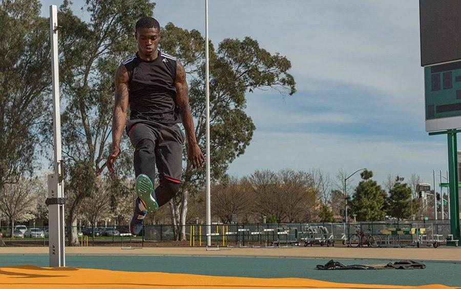 Sacramento State junior jumper Darius Armstead practices for high jump with some run throughs on March 10 at Hornet Stadium. Armstead is on the four-man squad of Sac State jumpers that finished the indoor season ranked fourth in the NCAA for track and field. (Photo by Matthew Nobert)