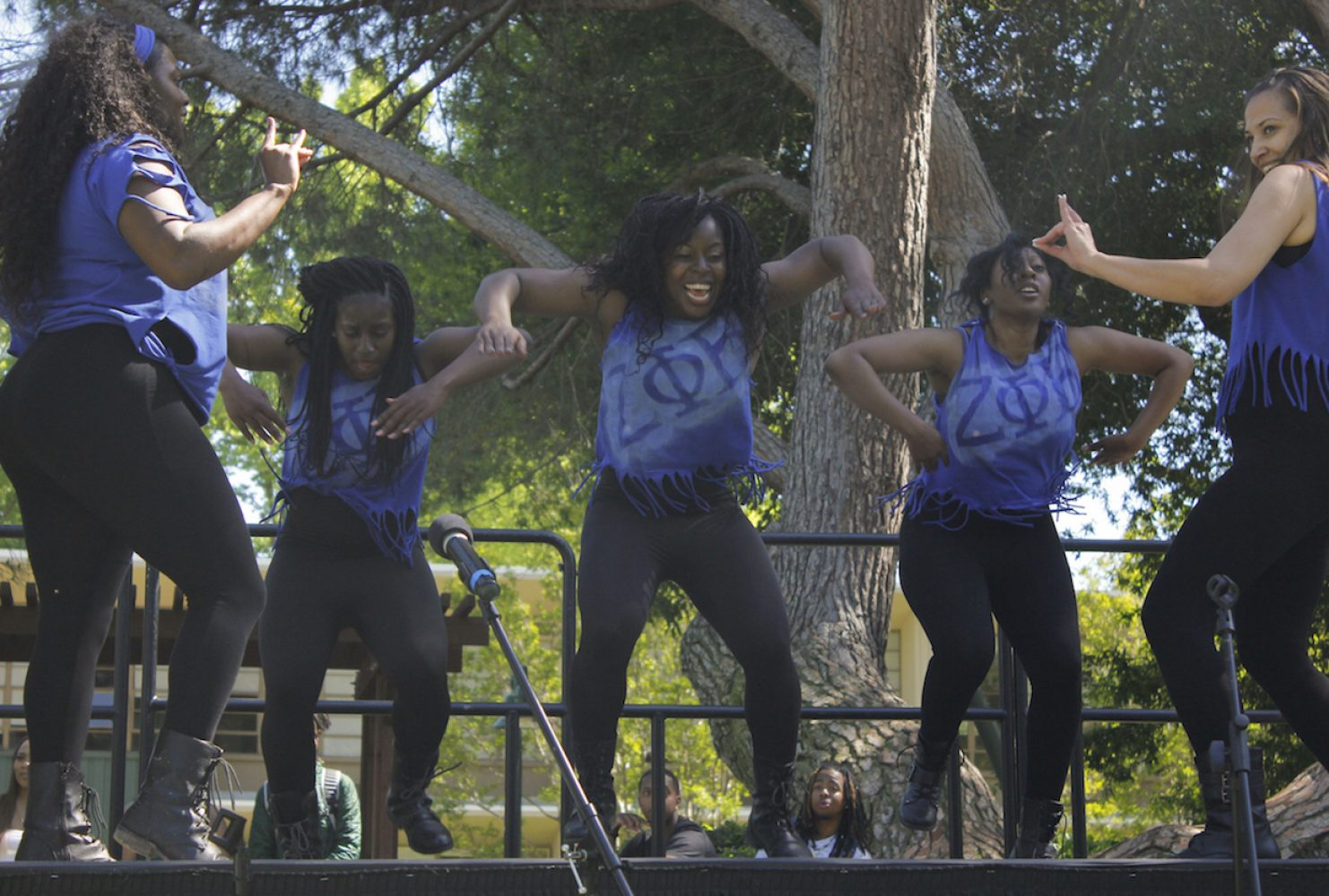 Sorority Zeta Phi Beta members perform step routines on stage during Sacramento State's first Black Family Day event on Saturday in the Main Quad. (Photo by Rin Carbin)