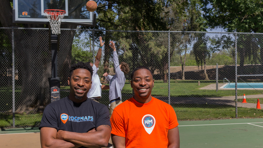 Sacramento State alumni Donte Morris, left, and Dominic Morris, right, created the app 'Hoop Maps' which allows users to find pickup basketball games in their area. The app was featured on KOVR-TV and ESPN's morning show 'SC6,' and has since been downloaded over 15,000 times. (Photo by Matthew Nobert)