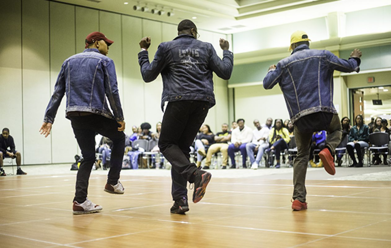 Brothers of the Alpha Phi Alpha fraternity placed second in the 4th Annual Capitol City Stroll-Off in the University Union Ballroom April 7. Partial proceeds will benefit March of Dimes, a organization that helps fight premature births. (Photo by Nicole Fowler)