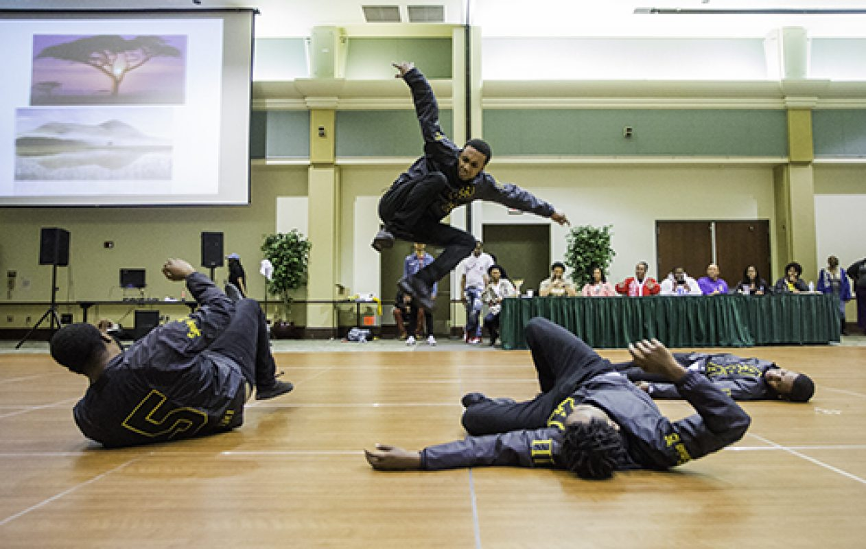 Brothers of the Alpha Phi Alpha fraternity perform in the freestyle round at the 4th Annual Capitol City Stroll-Off in the University Union Ballroom April 7. The group placed second in the contest. (Photo by Nicole Fowler)