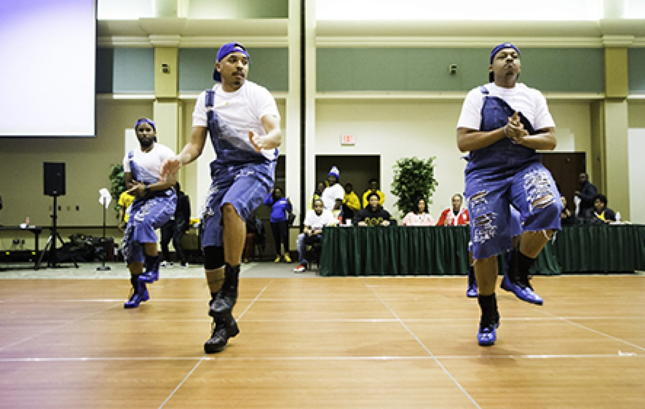 In the final round, members of the Phi Beta Sigma fraternity perform a freestyle stroll in the 4th Annual Capitol Stroll-Off Competition in the University Union Ballroom. Proceeds from the event will be donated to the March of Dimes Foundation. (Photo by Nicole Fowler)