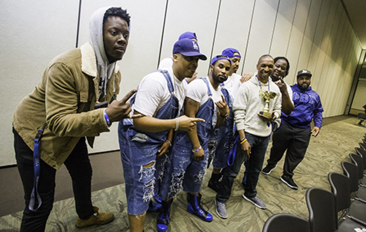 The brothers of Phi Beta Sigma fraternity pose with their trophy for placing first in the 4th Capitol City Stroll Off April 7 in University Union Ballroom. (Photo by Nicole Fowler)