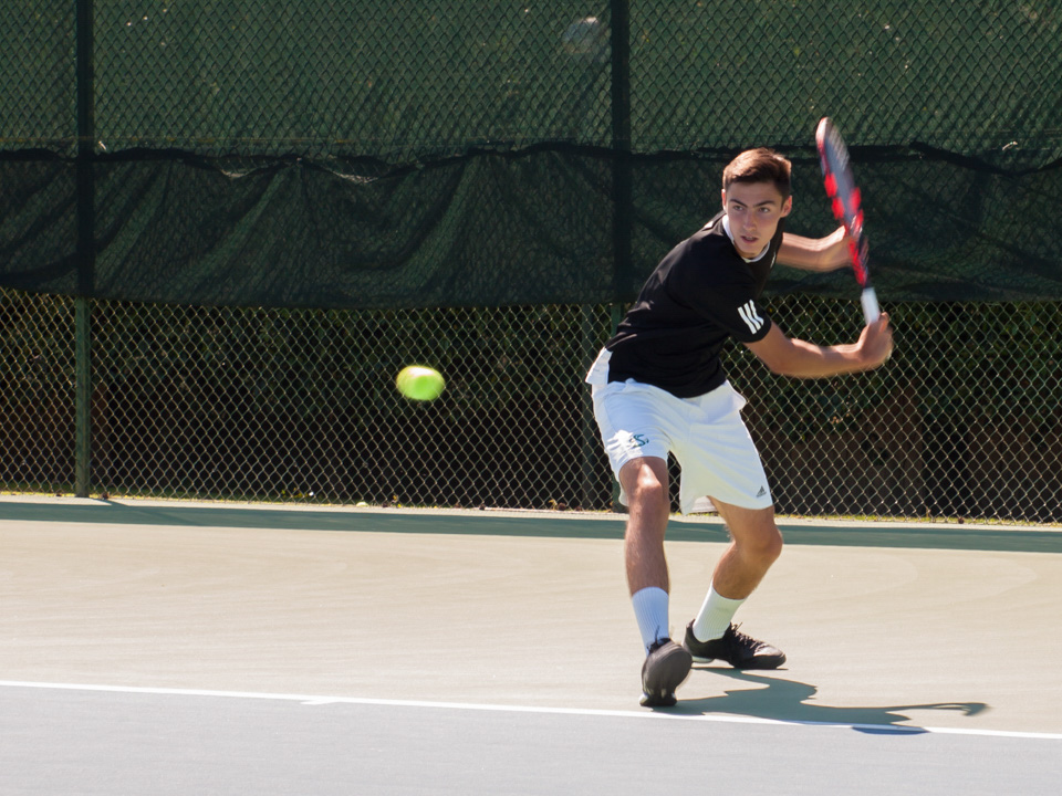 Sacramento State freshman Louis Chabut winds up to hit the ball against Northern Arizona Sunday at the Rio Del Oro Racquet Club. (Photo by Andro Palting)