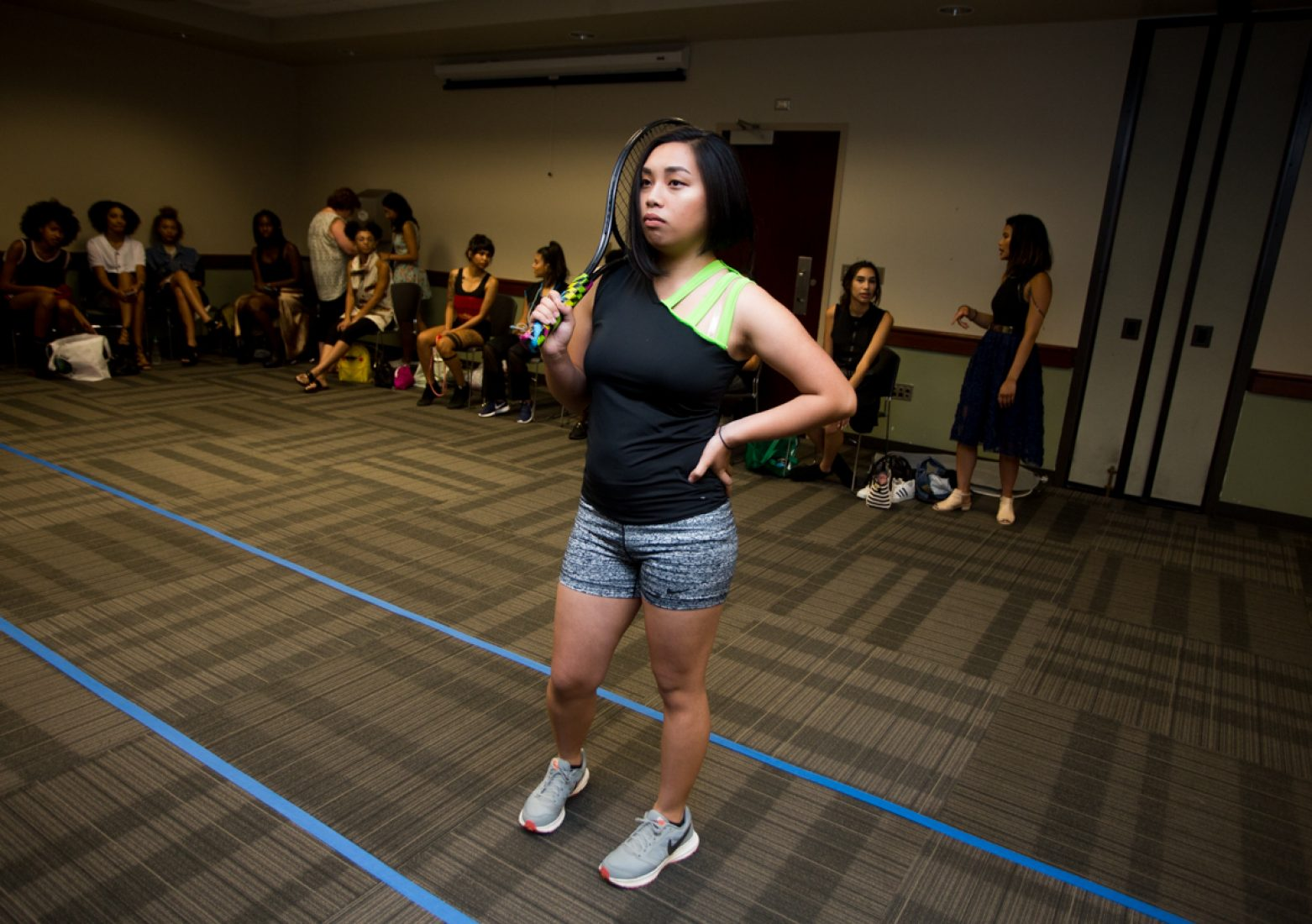 A model practices her runway walk in a Phua Lee design during rehearsal in the University Union Foothill Suite on Wednesday. Lee uses bright colors in the designers of her 'Take the Hint' collection. (Photo by Nicole Fowler)