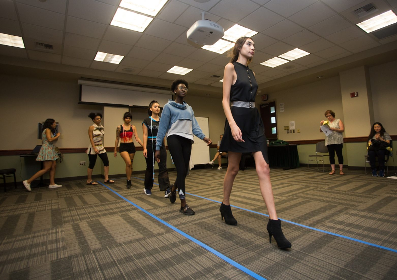 Models practice their runway walks during rehearsal in the University Union Foothill Suite on Wednesday. (Photo by Nicole Fowler)