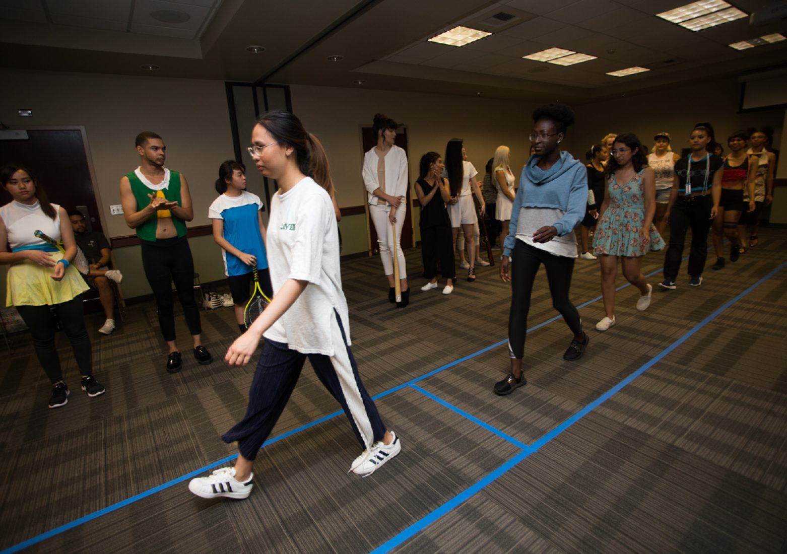Members from the Student Fashion Association, models and volunteers practice the show's timing during rehearsal in the University Union Foothill Suite on Wednesday. (Photo by Nicole Fowler)