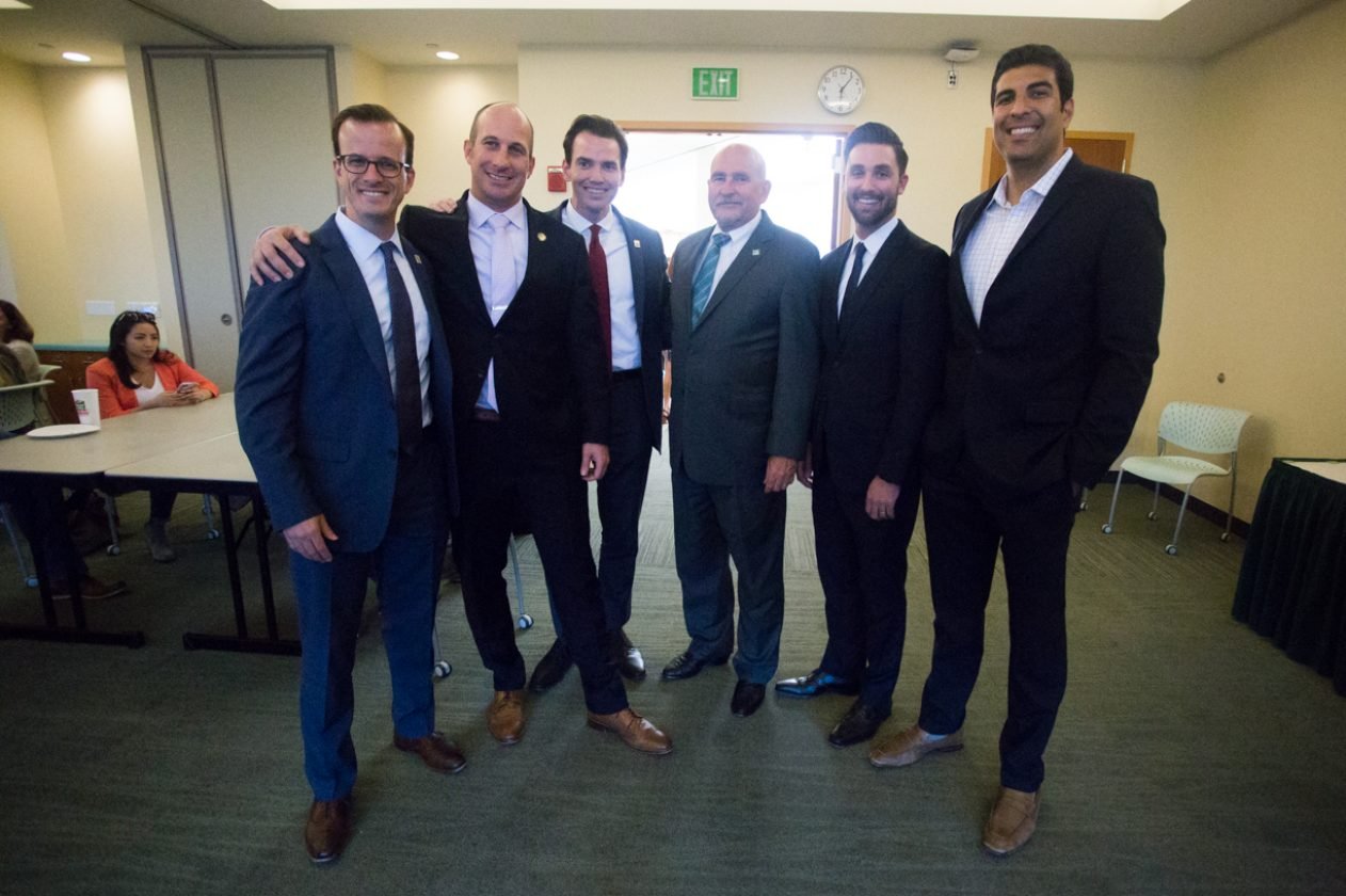 Sacramento State President Robert S. Nelsen, third from right, meets with the discussion panel (from left to right) Marc Berman, Heath Flora, Kevin Kiley, Ian Calderon and Matt Dababaneh on Tuesday in The Well's Terrace Suite. (Photo by Nicole Fowler)
