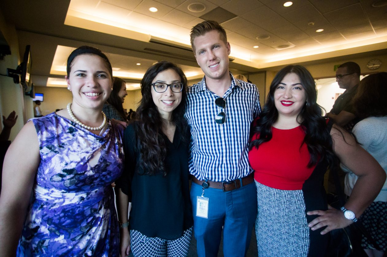 ASI President Patrick Dorsey poses with students during the informational first Millennial Caucus in the Well's Terrace Suite at Sac State. Dorsey was among the student government officials in attendance to the town hall-styled meeting which focused on issues surrounding millennials. (Photo by Nicole Fowler)