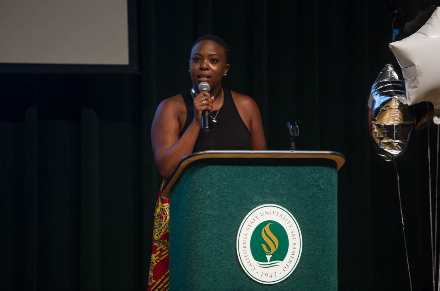 Sacramento State's social work advisor Melissa Muganzo speaks during the first Black & White Gala on Sunday in the University Union Redwood Room. (Photo by Nicole Fowler)