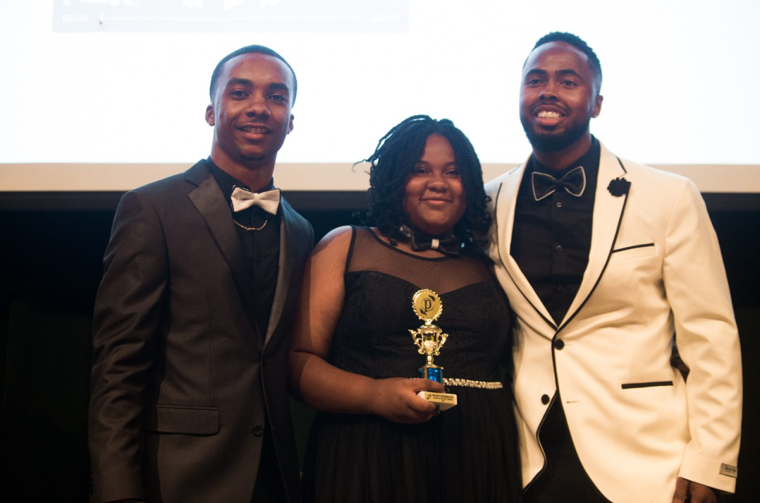 Journey Ashford, center, was one of the first youth mentees to receive a scholarship from Project Optimism during its inaugural Black & White Gala on Sundayin the University Union Redwood Room. (Photo by Nicole Fowler)