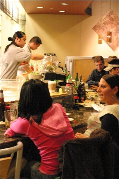 Image: Forget 'frying' Nemo:Customers enjoy their meal at the sushi bar.:Photo by: Melissa AllenState Hornet