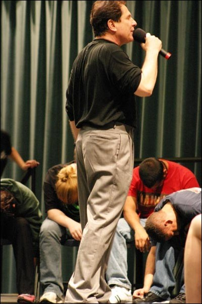 Image: Hypnotist has a few suggestions for students:Tom Deluca uses his suggestive powers of hypnosis on a group of students on April 13 at the University Union Ballroom. :