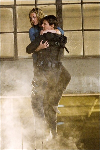 Image: This 'mission' is better than the rest:Ethan Hunt (Tom Cruise) right, rescues IMF Agent Lindsey Farris (Keri Russell) in