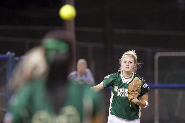 Third baseman Rachel Miles throwing to first base: