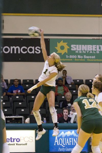 Senior Brittany Ferguson spikes the ball during the 3-2 win over Weber State in the Hornet's nest Oct. 4.: