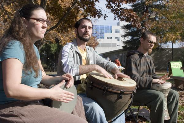Percussion majors Deborah Cordoza, Ben Prima and Reno Gordon a sociology major played for California Faculty Association trying to stop budget cuts in the Library Quad Nov. 19:Claire Padgett