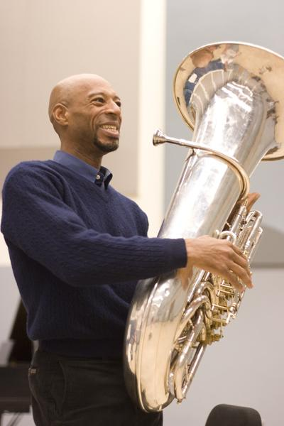 Julian Dixon with his tuba during a private lesson in Capistrano Hall.: