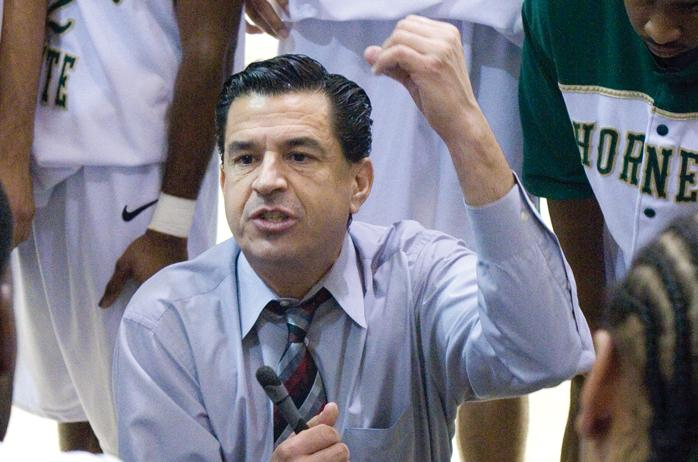 Brian Katz, the men's basketball team's head coach, above, speaks to the team during its game against University of California, Davis.: